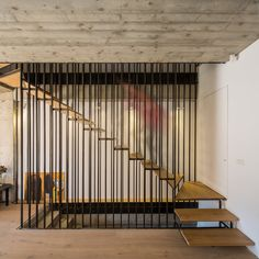 Wood and steel, heavy materials, work together to create a light, floating staircase