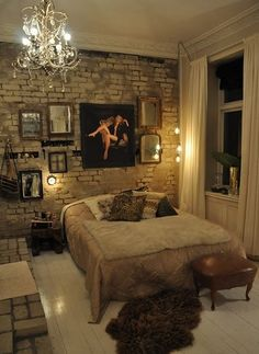 i love the exposed brick wall in here. not necessarily in the bedroom but i'd love to have one for my living room