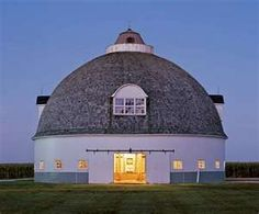 A round 1918 former cattle barn in Pontiac, Illinois, with a central silo and four dormers, was restored by owner Bill Nolan with help from the Barn Again! program of the National Cattle Barn, Farm Barn, Country Barns, Old Barns, Country Living, Horse Barns, Horses, Unusual Buildings, Beautiful Buildings