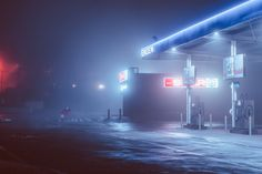 Photographer Elsa Bleda captures hazy moments that linger on the outskirts of the cities she visits in Eastern Europe and South Africa. Bleda is drawn to nighttime scenes bathed in colored light, such as a flock of pigeons illuminated by pink neon, or a lone gas station emitting an eerie blue glow.