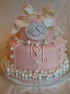 Simply beautiful monogrammed bridal shower cake.  See more bridal shower cake ideas at www.one-stop-party-ideas.com