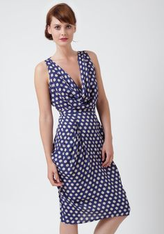 Love this blue polka dot dress. I'd wear it with red heels.