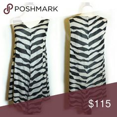 Oska Knit Uneven Hem Tunic Great condition. Lightweight knit fabric. Can be worn as a dress if you're petite. Oska Tops Tunics