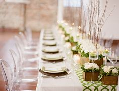 wooden boxes + green and white florals + green patterned table runner