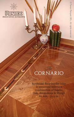 The CORNARIO hardwood border here presented with a red color parquet flooring. More at: http://www.pavexparquet.com/en/gallery/no103-parquet-floor-border-cornario.htm