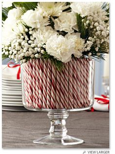 Use a trifle dish lined with candy canes as a vase for a festive arrangement.