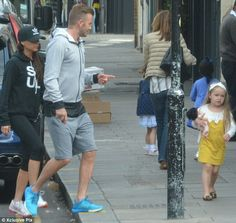 Family fun: David and Victoria Beckham were spotted out and about in West London on Tuesda...