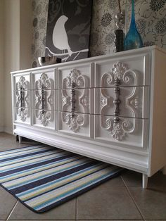 Ornate White Dresser. to get a pewter type of look by spray painting with silver and than glazing with black