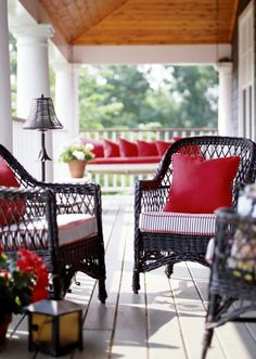 great porch...dark wicker, ticking stripe cushions, all accented with red.