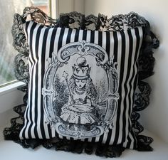 Victorian black and white stripped pillow with lace trim.