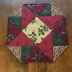 This beautiful octagon red, green and beige quilt is great for the holidays. This quilt measures 14 from point to point. The quilt is made from 100% Moda cotton fabrics. The back fabric is a green Moda print that will work year round. The middle layer of the quilt is made of Warm and Natural cotton batting. It was handmade by me in a smoke free environment. It is machine washable, on a delicate cycle with cold water.