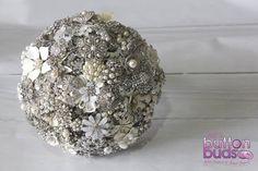 An elegant #silver and #white #broochbouquet is always a popular choice with #brides.  #alternativebouquet #stunning #brooches #sparkles #alternative #wedding #bride  #melbourneweddings  #marriage #weddingday #broochbouquets #fashion #flowers #weddingflowers #australia  www.nicsbuttonbuds.com.au www.facebook.com/nicsbuttonbuds www.pinterest.com/nicsbuttonbuds www.instagram.com/nicsbuttonbuds www.twitter.com/nicsbuttonbuds