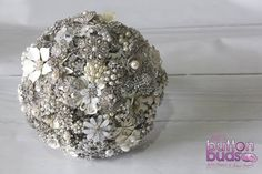 An elegant #silver and #white #broochbouquet is always a popular choice with #brides.  #alternativebouquet #stunning #brooches #sparkles #alternative #wedding #bride  #melbourneweddings  #marriage #weddingday #broochbouquets #fashion #flowers #weddingflowers #australia  www.nicsbuttonbuds.com.au www.facebook.com/nicsbuttonbuds www.pinterest.com/nicsbuttonbuds www.instagram.com/nicsbuttonbuds www.twitter.com/nicsbuttonbuds