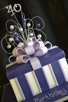 Purple Gift Box - A 40th birthday cake which is a Hazelnut praline truffle cake soaked in Frangelico syrup.