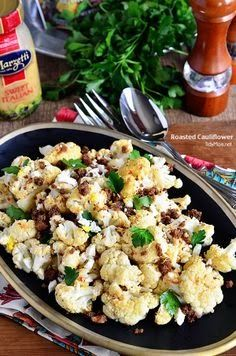 The BEST Roasted Cauliflower recipe with Italian dressing, feta cheese and browned butter crouton crumbs