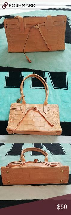 Final Price Drop 😊 Leather Dooney and Bourke Gorgeous peach color, used once, excellent condition, feet on bottom, cute details, gold hardware, 3 pockets inside, one is zippered, excellent condition, magnetic button closure, 11 inches long, 7 inches tall, 3 inches wide, leather Dooney & Bourke Bags Mini Bags