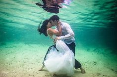 Destination bride and groom kiss underwater. Trash the Dress Photography in Mexico by Magic Art Wedding Studio
