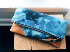 The CONSTELLATION clutch(As featured in Foam Magazine and the Globe and Mail)Beautiful thick hand dyed cotton combined with distressed Italian leather makes this extra large pouch a versatile carry-all, travel companion or evening clutch.~ measures 13