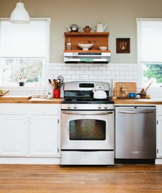 white cabinets + stained butcher block + subway tiles