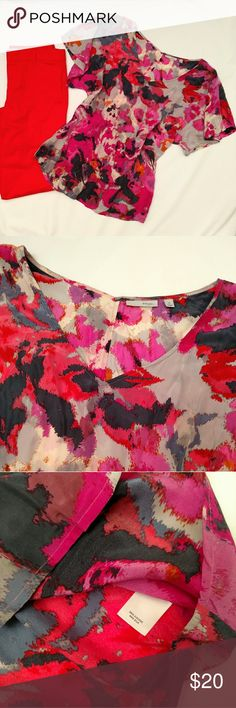Abstract print silk blend blouse Pink, coral, slate, and cream get together in an abstract print. This top works well for work and play alike. Flowy short sleeves, slightly flared shape, wide v-neck. viscose/silk blend.  Looks great with the size XS coral blazer available in another listing.  excellent used condition. questions and offers welcome! Halogen Tops Blouses