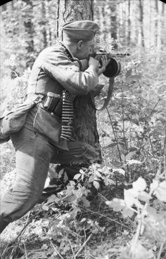 German soldier using a Soviet machine gun, Army Group North, Soviet Union, 1941.