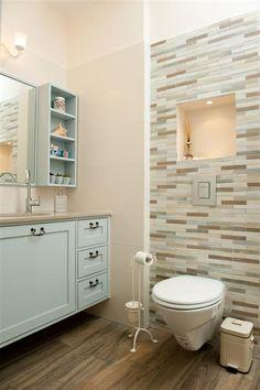 hmmm a type of backsplash deal behind the toilet...for master bathroom