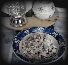 Peppermint Muddy Buddies!  Used Andes Creme de Menthe chips b/c I ran out of semi-sweet chocolate chips.  Blasphemy, I know.  Worked well.  A little too well b/c now I can't stop munching and these are to be mailman, bus-driver, teacher gifts!