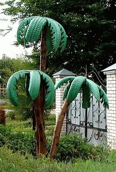 recycled-crafts reuse-recycle- old-tires into palm trees yard art