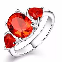 Beautiful Red Ruby 925 Sterling Silver Ring 3.5 it Red Ruby. Oval Center stone Two side Hearts Stones. 925 Stamped Sterling silver Ring. Size 9. Brand new never worn. Wrapped and shipped with care, no box included. VALENTINES DAY  Fire and Ice Jewelry Rings