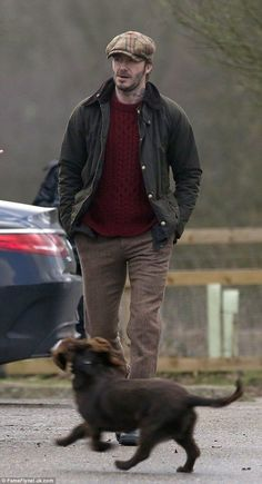 www.Vagabond-Dogs.com . One man and his dog! David Beckham dons his best tweed flat cap to shoot an advert in the park in London... and brings along his beloved pooch Olive as his co-star