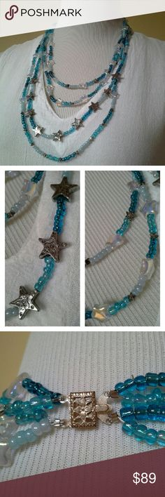 "Handcrafted Glass Stars & Hearts Necklace Iridescent pearlized stars among aqua and turquoise iridescent glass beads, turquoise stars, and swirl-etched silver star beads. Weighty and warms to your skin as you wear it. Gorgeous vintage silver pinch clasp. 4 strands, the shortest approx 22.5"", the longest 30.5"" long. Jewelry Necklaces"