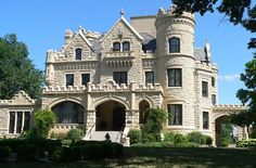 The George & Sarah Joslyn Home (known locally as Joslyn Castle), is a mansion in the Gold Coast Historic District of Omaha, Nebraska. Built in the Scottish Baronial style in 1903, the 35-room mansion had four stories, as well as a carriage house tower, built before the Castle in 1901. The home was built in just eleven months at a cost of $250,000. The Castle and the carriage house were built of Kansas silverdale limestone. There is a wrought iron door on the Castle that weighs over a ton.