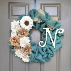 This turquoise burlap wreath is made completely from burlap! As you can see, the flowers are made from burlap that adorn the left side of the