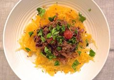 Lean Bolognese with Spaghetti Squash - spaghetti squash, lean beef mince (might sub chicken/turkey), chili flakes, dried Italian herbs, canned chopped tomatoes, cherry tomatoes, garlic cloves, red onion, coconut oil (might sub olive oil)