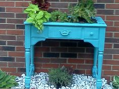 My $5 yard sale repurposed sewing table into planter.