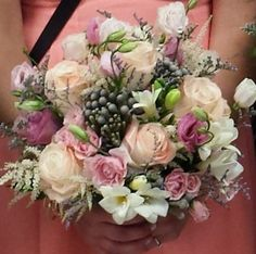 Pink and coral colors make a beautiful bouquet for a sophisticated bride