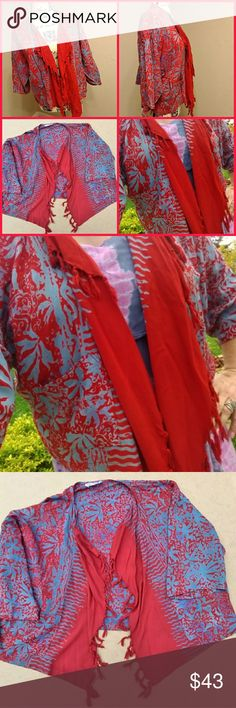 "Stunning Indonesian ""Wild Woman"" Kimono Blouse Handmade in Indonesia! Gorgeous!! Amazing condition.  Worn only 1 time.  Wrinklely,  but I won't iron it. I ruin everything!  Haha! Vibrant red and blue.  Changes hue in different lighting.  Super comfortable.   100% Rayon Enjoy! Wild Woman Tops Blouses"