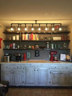 Open shelving and light fixture using gas pipes