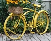 charming yellow bike up-cycled as garden art . . . wish i still had my bicycle that my PaPa painted blue . . . just.like.this. ;)
