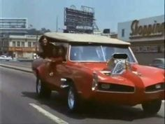 Here's a video clip of one of my favorite cars from a show I watched with my brother and sister when we were little kids in the 70s & 80s... the Monkeemobile built by George Barris.   Other great cars from that era built by George Barris were the Batmobile, Green Hornet's Black Beauty, The Munsters Koach, Grandpa Munster's Dragula Coffin, Bo Duke's General Lee and K.I.T.T. from Knight Rider.  His cars were the icing on the cake of some classic kids shows.  His website:  http://www.barris.com