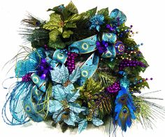door Wreath Peacock Passion Christmas Holiday ExQuisitE have matching centerpiece by Cabin Cove Creations. $220.00, via Etsy.