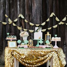 Inexpensive wedding decor - Gold sequin tablecloth for display table.