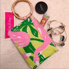 NEW  Lilly Pulitzer bamboo wristlet Festive, fun, and fashionable Fan Dance floral canvas wristlet with bamboo handle is ideal for your cell phone and credit cards. Lightly padded for a bit of extra protection. Lilly Pulitzer for Target sold out on the day of release and will not be carried again. RARE! No longer sold in sold in stores. Brand new with tags! Lilly Pulitzer Bags Clutches & Wristlets