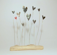 tin hearts in driftwood by Josephine Gomersall designs
