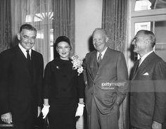 American film actor and screen idol Clark Gable (1901 - 1960) (left), his wife, fashion model Kay Gable (nee Kathleen Williams and formerly Kay Spreckels), and film producer William Pearlberg (1900 - 1968), pose in the White House with US President Dwight Eisenhower (1890 - 1965), Washington DC, April 2, 1958.