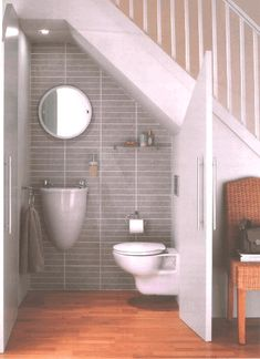 Tiny bathroom under the stairs. Great idea if you put in the turning steps up to the loft in the tiny house Tiny bathroom under the stairs. Great idea if you put in the turning steps up to the loft in the tiny house Space Under Stairs, Bathroom Under Stairs, Master Bathroom, Downstairs Bathroom, Basement Bathroom Ideas, Small Downstairs Toilet, Small Space Staircase, Basement Ideas, Office Bathroom
