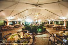 rustic garden wedding evening time in tent,   Photo credit to Creation Studios of Memphis