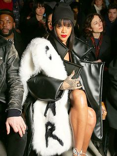 RIHANNA | Even when she's not on the runway, she's stealing the models' thunder. This time, it's thanks to her loud oversize coat, worn front row at the Comme des Garçons show.