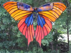 Colors of the Sunset, Golden Orange Blue andyYellow Scarce Swallowtail Butterfly Stained Glass Suncatcher. $300.00, via Etsy.