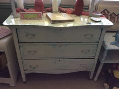 """white vintage dresser. Distressed blue hi lights. Dimensions- 42""""W 21""""D 34"""" tall. For questions, or to avoid shipping costs contact Aunt Bea's, call or text, at 574-238-8635. OR Call J&P Auto & More,"""